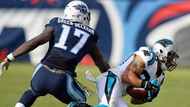 Panthers free safety Kurt Coleman, right, intercepts a pass intended for Titans wide receiver Dorial Green-Beckham in the second half.