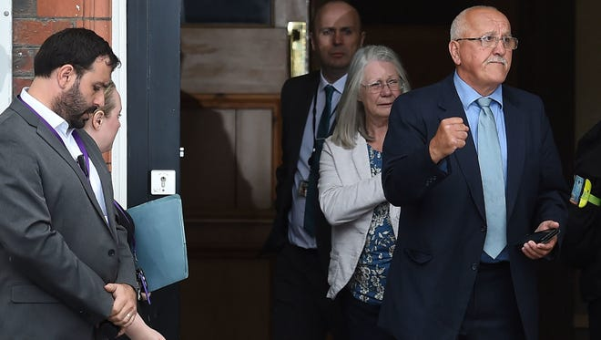 Family members affected by the 1989 Hillsborough stadium disaster exit Parr Hall after being informed of the charging decisions by the Hillsborough CPS, in Warrington, east of Liverpool on June 28.