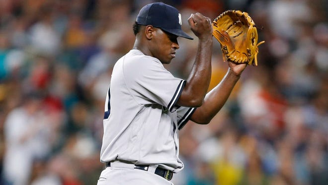 New York Yankees starting pitcher Luis Severino (40) reacts after getting the final out of the seventh inning against the Seattle Mariners at Safeco Field.