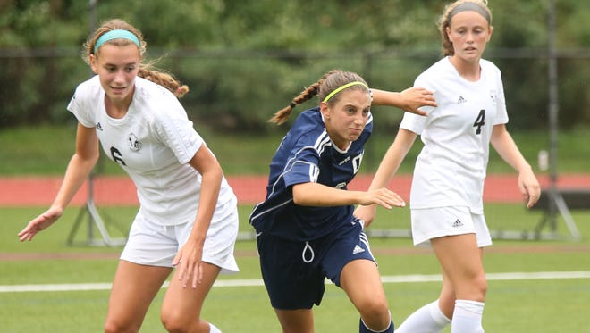 Sophomore Samantha Derrico (center) is NV/Old Tappan's top forward and should return from injury by October.