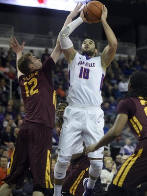 University of Evansville forward Mislav Brzoja shoots over Loyola's Julius Rajala during the first half of their game at the Ford Center in Evansville Tuesday, Jan. 19, 2016.