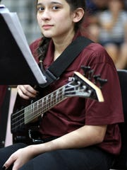 Eighth grader Angelic Porras waited patiently to strum her guitar during the RMMS portion of the concert. The seventh- and eighth-grade band students were conducted by Sergio Beraun and Sam Villareal.