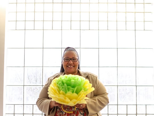 Laneika Musalini, Director of Grants Institutional Advancement at Tri-County Technical College in Pendleton, keeps the yellow paper flower she made for the 2015 Anderson Interfaith Ministries luncheon. Musalini, a former Women and Children Succeeding participant for AIM, gave her life changing story to a crowd of 700 then, and was honored by the organization for her success.