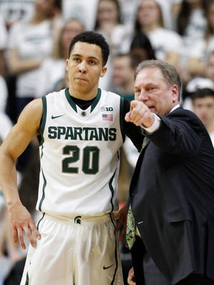 Michigan State' Travis Trice listens to instructions from head coach Tom Izzo during break in the first half of their basketball game against Illinois on Saturday, February 7, 2015 in East Lansing.