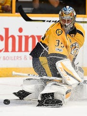 Nashville Predators goalie Pekka Rinne (35) deflects