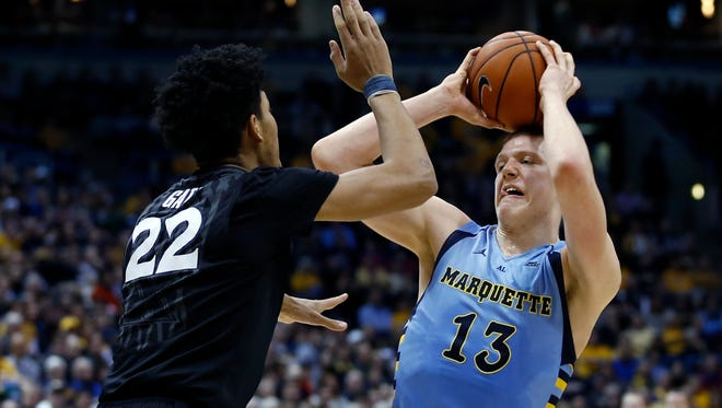 Marquette's Henry Ellenson, right, plays against Xavier on Jan. 16, 2016, in Milwaukee.
