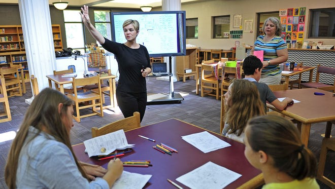 Teacher Leah Bishop speaks to a group of seventh-graders during orientation at Freedom Middle School in Franklin.