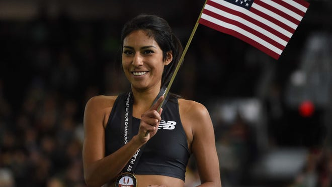 Brenda Martinez poses with her medal and flag after winning the women's 1,500 during the 2016 USA Indoor Championships at the Portland Convention Center.