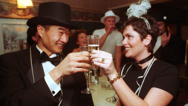 In this 1999/2000 file photo, Min Felten and Angela Cook, both of Wausau, ring in the new year and millennium with a toast and a laugh at the Hiawatha Lounge.