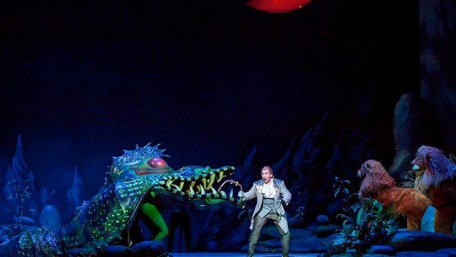 "Tenor Joshua Dennis as Tamino in Michigan Opera Theatre's production of ""The Magic Flute."""