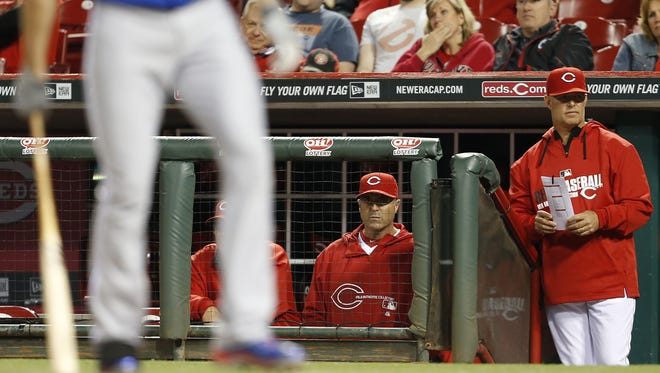 Cincinnati Reds manager Bryan Price (38) and bench coach Jay Bell watch during the ninth inning against the Chicago Cubs.