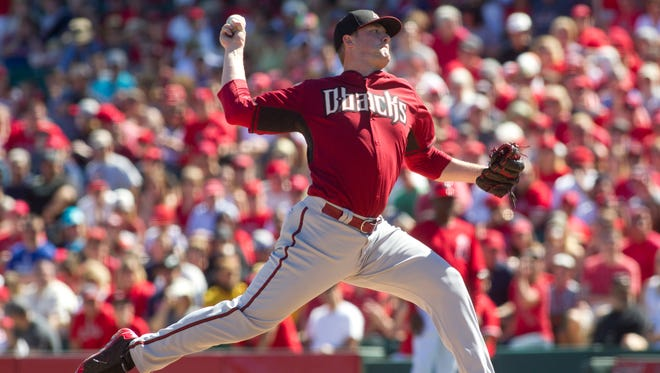 Diamondbacks pitcher Archie Bradley throws during the first inning of a spring training game against the Angels on Saturday, March 8, 2014, at Tempe Diablo Stadium.