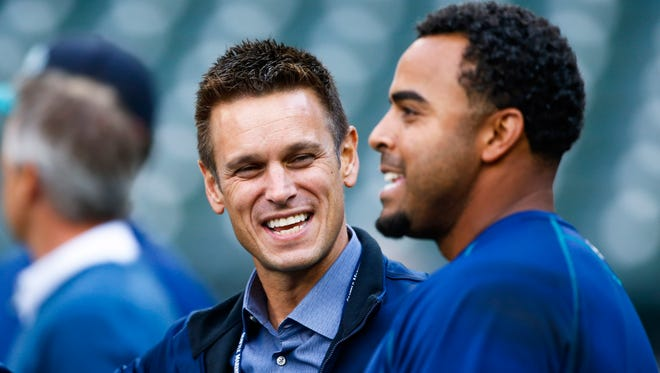 Mariners general manager Jerry Dipoto (left), shown talking with slugger Nelson Cruz during batting practice last year, has had a busy offseason, making 11 trades involving 30 players, plus two free-agent signings and two waiver claims.
