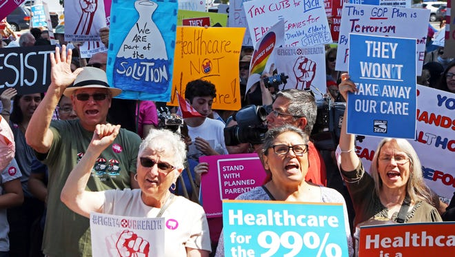Doctors, nurses, health care workers and patients who will lose access to health care or see costs rise attend a rally against the GOP health care bill at Harbor-UCLA Medical Center in Torrance, Calif., on July 3, 2017.