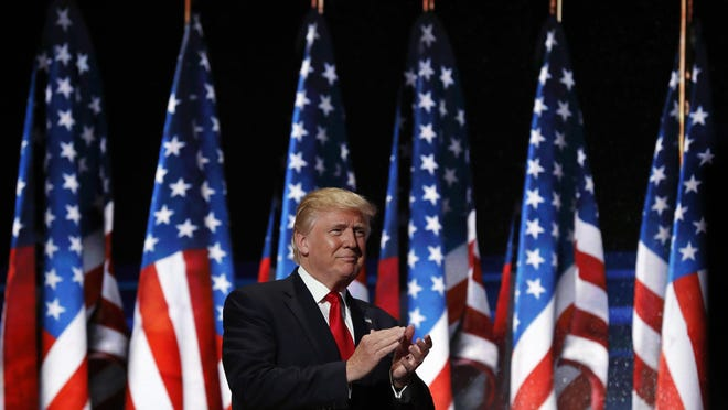 President Donald Trump had planned at one point to accept the GOP nomination for a second term in Jacksonville. In this file photo, Trump walks to the podium during the 2016 Republican National Convention in Cleveland.