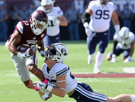 Mississippi State wide receiver Keith Mixon (23) knocks
