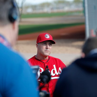 Reds manager Bryan Price talks to the media during