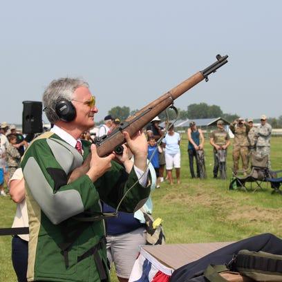U.S. Rep. Bob Latta, R-Bowling Green, prepares to fire