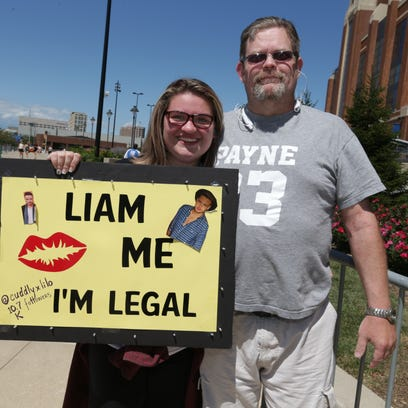 KC, left, and Eric Womack, right,  attend the One Direction