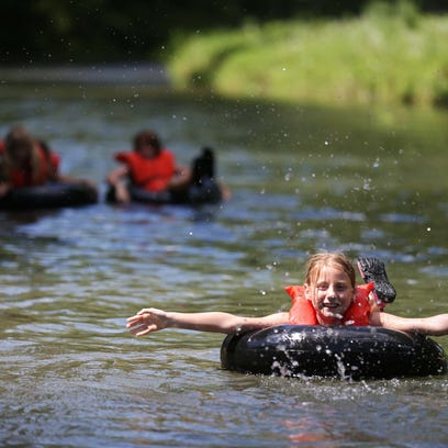 Campers float down Bear Creek on July 21, 2015 during