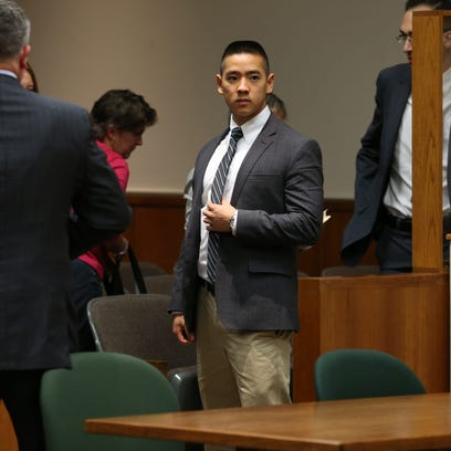 Charles Tan leaves court Thursday after a mistrial