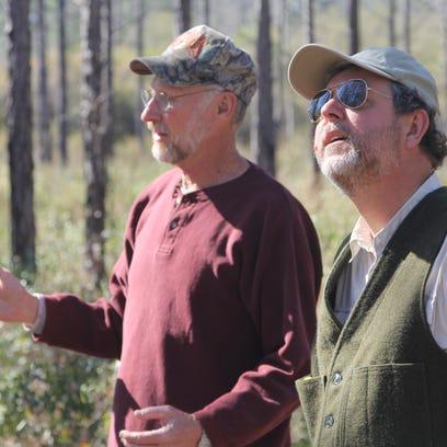 Retiring Leon County Forester Stan Rosenthal, right,