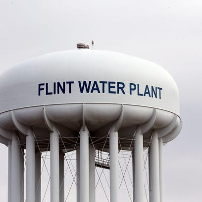 A water tower in Flint, Michigan, is shown on Friday.