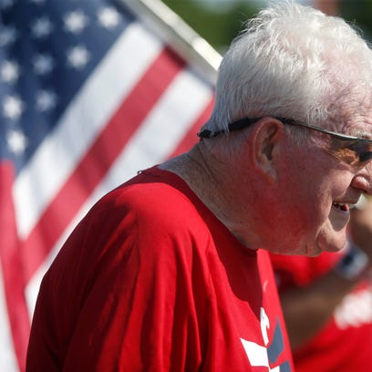 Ernie Andrus, a 92-year-old WWII veteran, runs along