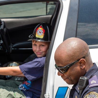 HPD Sgt. Jason Reed shows Joshua Hopkins Jr. of Sandersville
