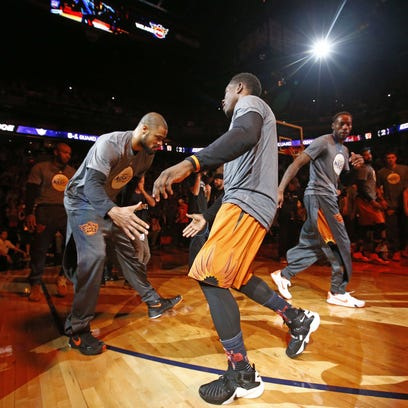 Phoenix Suns' Tyson Chandler and Eric Bledsoe during