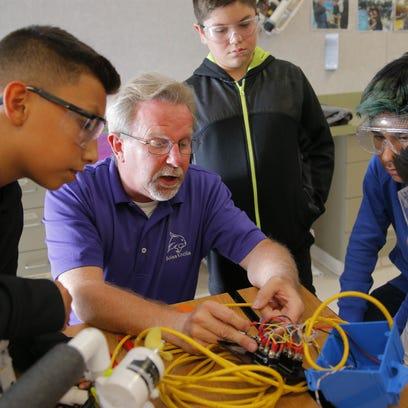 Bolsa Knolls teacher Stanley Wyman helps students with
