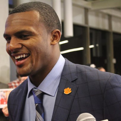 Deshaun Watson talks to reporters on the red carpet