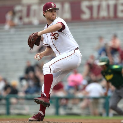 FSU's Andrew Karp pitches  against USF on Tuesday.