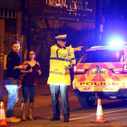 Police stand by a cordoned off street close to the