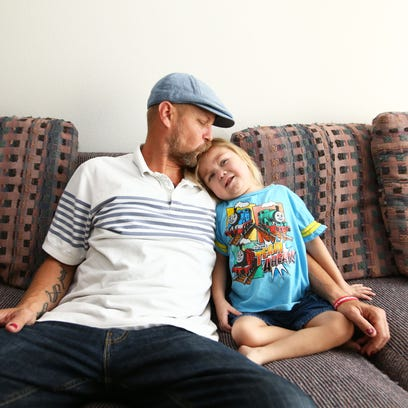 Kevin Scarbrough and his 4-year-old son Anthony snuggle