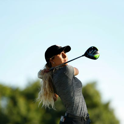 Shannon Aubert plays her tee shot on the 18th hole