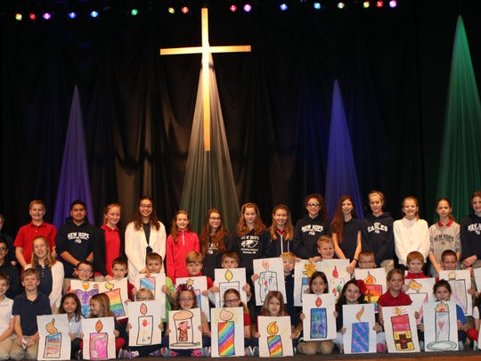 The seventh- and second-grade Chapel Buddies led the