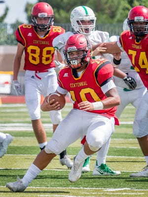 Centennial quarterback Noah Bartlett gets into the Albuquerque High secondary and makes a cut for extra yardage Avery Winslow Saturday afternoon at the Field of Dreams.