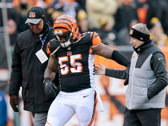 Cincinnati Bengals outside linebacker Vontaze Burfict (55) pushes off help from the training staff as he leaves the field injured in the second quarter of the NFL Week 15 game between the Cincinnati Bengals and the Pittsburgh Steelers at Paul Brown Stadium in downtown Cincinnati on Sunday, Dec. 18, 2016. At halftime the Bengals led 20-9.