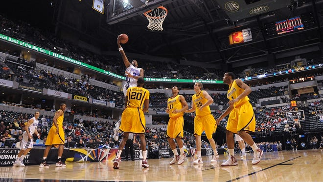 FILE - JerShon Cobb scores early for Northwestern in a Men's Big Ten Tournament game March 8, 2012 at Bankers Life Fieldhouse in Indianapolis.
