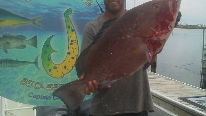 Area angler Jeremy Byrd shows off a 22-pound red grouper he caught in August while fishing with Heller High Water Charters.