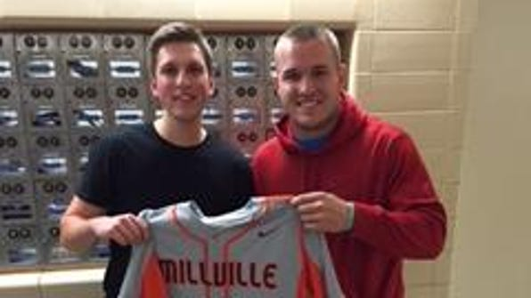 Mike Trout (right) awarded Millville senior Paul Harris