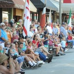 People lined the sidewalks of Main Street Waynesville as the the Parade of Nations, one of the last Folkmoot events, is held Saturday. John Coutlakis 7-26-14