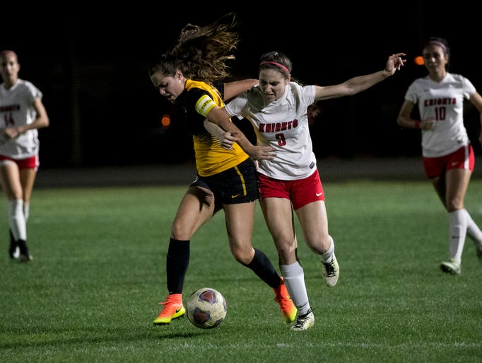 Michele Cohen of North Fort Myers tries to get past