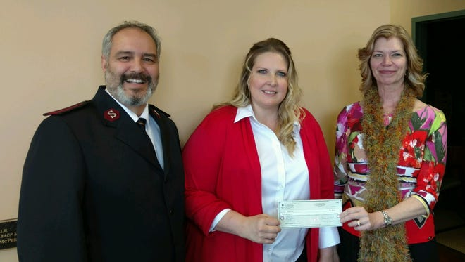 From left, are Ray and Heidi Valdezof the Salvation Army,and Lisa Workman, president of The Community Foundation for Crawford County.
