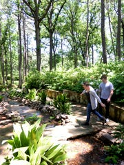 A couple strolling through Norton Gardens, located at 4747 Creswell Ave. in Shreveport.