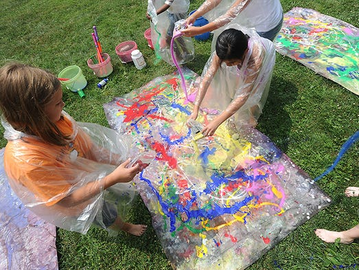 Students used paint and materials of varying viscosity to create art inspired by the Abstract Expressionism works and techniques of Jackson Pollock during Tuesday's Art in the Park program at the Hopewell Culture National Historic Park.