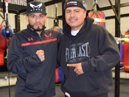 Robert Garcia, right, remains a trainer of some of the top fighters in the world, including Abner Mares, left.
