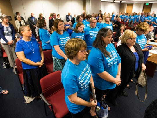Supporters for HB2442 stand to show their support during