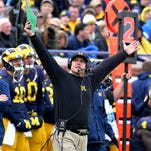 Michigan head coach Jim Harbaugh reacts after linebacker Joe Bolden was ejected for targeting against MSU in Ann Arbor Saturday 10/17/2015.  Mich